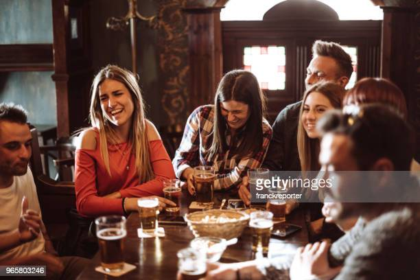 people talking indoors in a pub with the beers - pub stock pictures, royalty-free photos & images