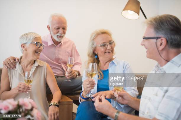 People talking over a glass of wine