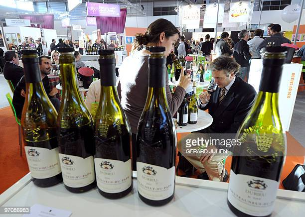 People taste 'Chateauneuf du Pape' wine at a stand on February 23 2010 in Montpellier southern France during the 9th edition of the 'Vinisud' event...