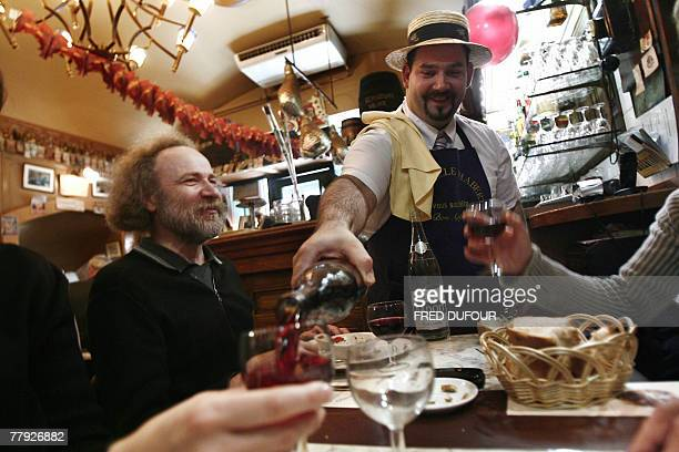 People taste the Beaujolais Nouveau wine 15 November 2007 in a restaurant of Lyon central eastern France Despite the release of a new rose Beaujolais...