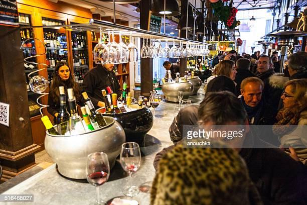 People tasting wine at Mercado San Miguel, Madrid, Spain