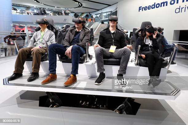 People test the Ford Future Mobility VR Expeience at the 2018 North American International Auto Show January 16, 2018 in Detroit, Michigan. More than...