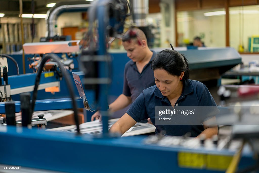 People textile printing at a factory : Stock Photo