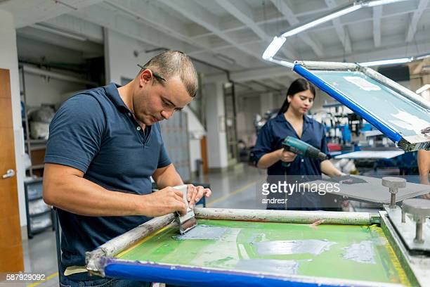 People textile printing at a factory