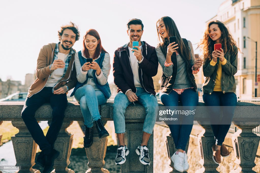 People Texting In The City Stock Photo