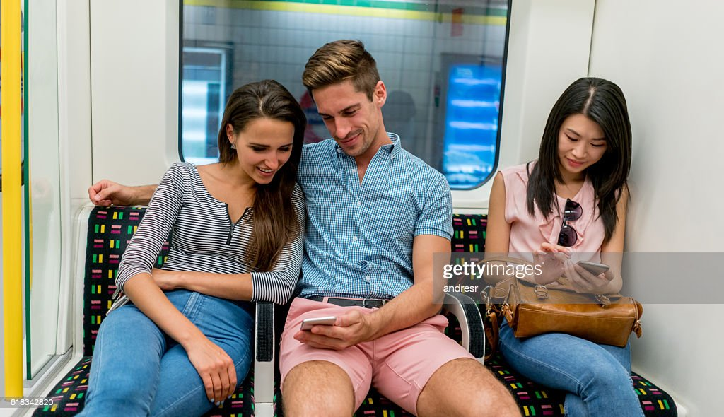 People texting while riding the metro : Stock-Foto