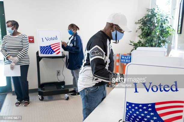 People their cast ballots at the Richland County Voter Registration & Elections Office on the second day of in-person absentee and early voting on...