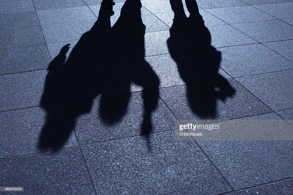 People threatening in blue night shadows : Stock Photo