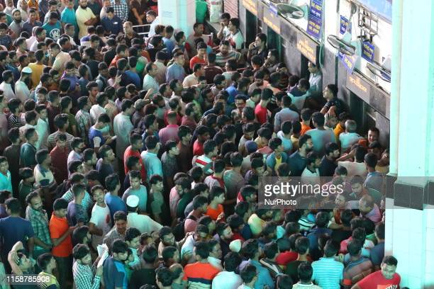 People throng at the Kamalapur railway station to collect advance tickets ahead of Eid alAdha in Dhaka Bangladesh on July 31 2019