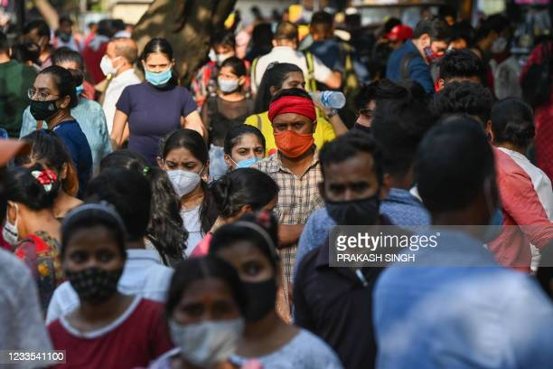 People throng Sarojini Nagar market for shopping after authorities eased a lockdown imposed as a preventive measure to curb the spread of the...