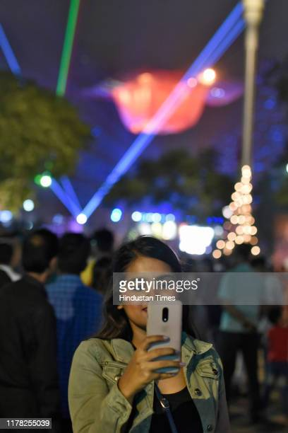People throng the venue of Laser show organised by Government of Delhi on the occasion of Deepawali at Central Park Connaught Place on October 26...