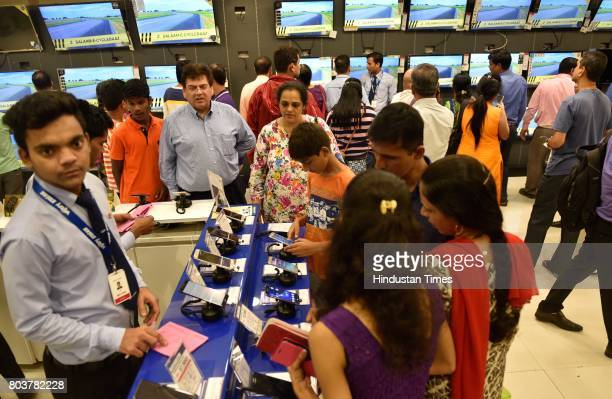 People throng to buy electronic goods a day before GST Implementation as Vijay Sales has given up to 50% discount at Prabhadevi on June 29 2017 in...