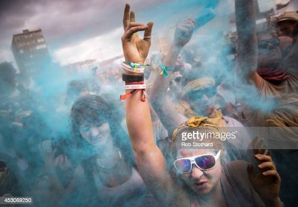 People throw brightly coloured powder at the Holi One festival at Wembley Park on August 2 2014 in London England The event is inspired by the spring...