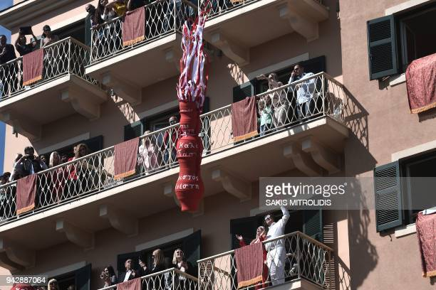 TOPSHOT People throw clay pots filled with water off balconies as they take part in a custom at Corfu island that takes place on Holy Saturday...
