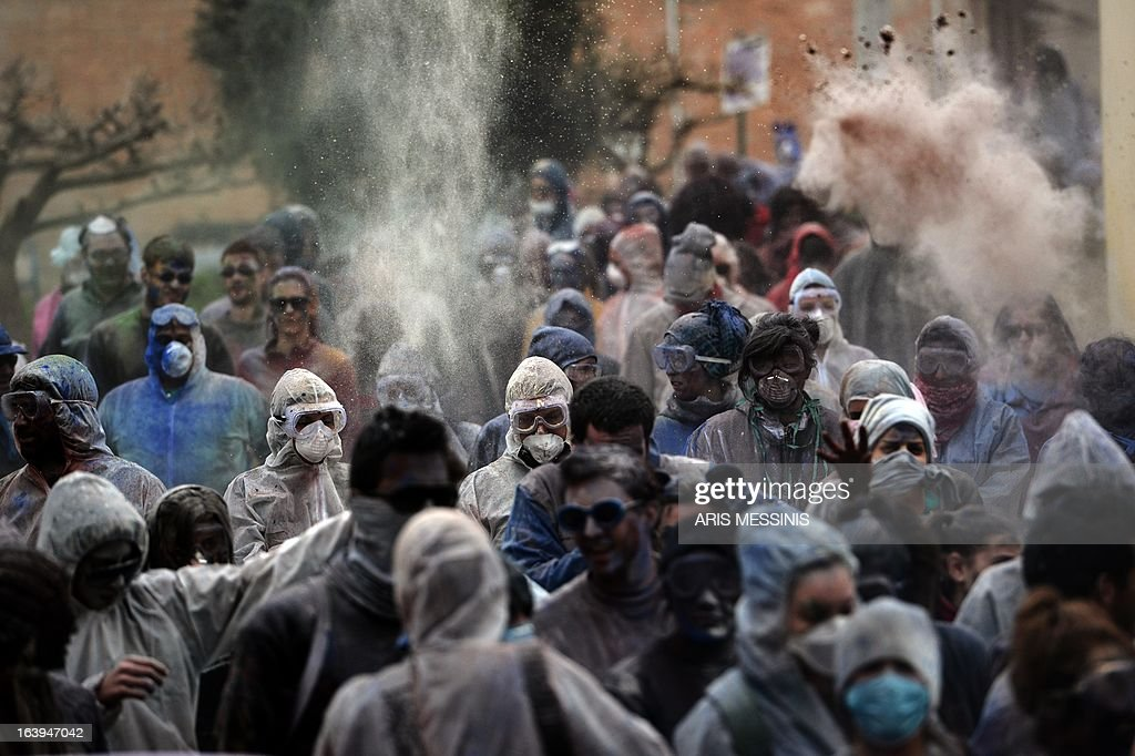 People throw flour at each other as they celebrate the annual custom of Flour War in Galaxidi, some 250kms south east of Athens on March 18, 2013.
