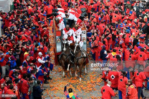 TOPSHOT People throw oranges to each other during the traditional Oranges battle of Ivrea Carnival near Turin on February 11 2018 Established in 1808...