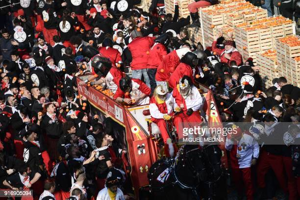 People throw oranges to each other during the traditional Oranges battle of Ivrea Carnival near Turin on February 11 2018 Established in 1808 the...