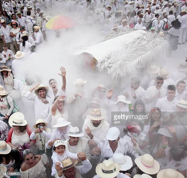 People throw talcum powder at one another as they take part in the carnival of 'Los Indianos' in Santa Cruz de la Palma on the Spanish Canary island...