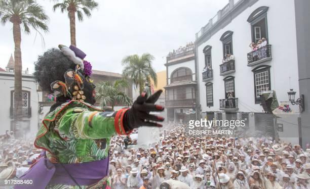 People throw talcum powder during the street carnival 'Los Indianos' in Santa Cruz de la Palma on the Spanish Canary island of La Palma on February...