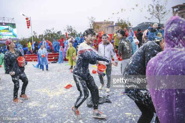 People throw Tofu at each other during TOFU Festival on February 18 2019 in Qingyuan China Tofu Festival is a traditional festival in the village On...
