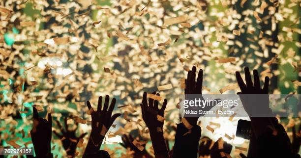 people throwing confetti in mid-air during celebration - celebration event stock photos and pictures