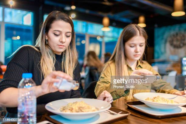people throwing salt and pepper before they start eating - road salt stock pictures, royalty-free photos & images