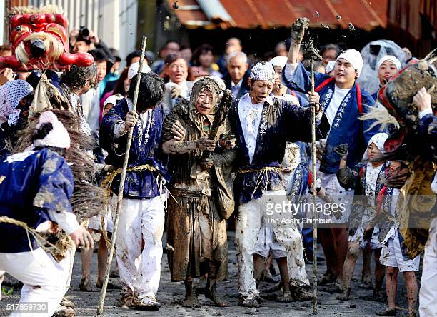 People throws mud at the Daiguji representative of shrine parishioners during the 'Dorouchi ' festival at Aso Jinja Shrine on March 27 2016 in...