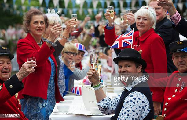 People toast as they take part in a street party organised by residents of Battersea in south London on June 2 as Britain celebrates Queen Elizabeth...