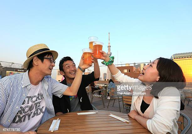 People toast at an outdoor beer garden on May 26 2015 in Tokyo Japan The highest temperature in central Tokyo was 309 degrees Celsius exceeded 30...