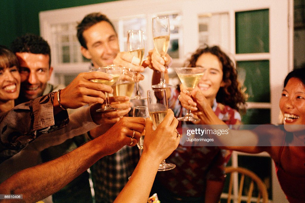 People toasting beverages : Stock Photo