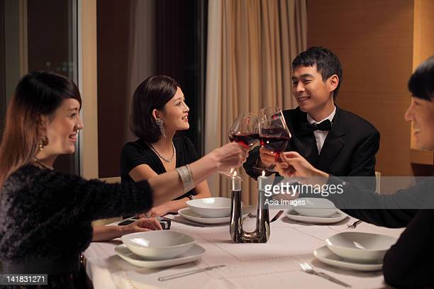 People toasting during a dinner party