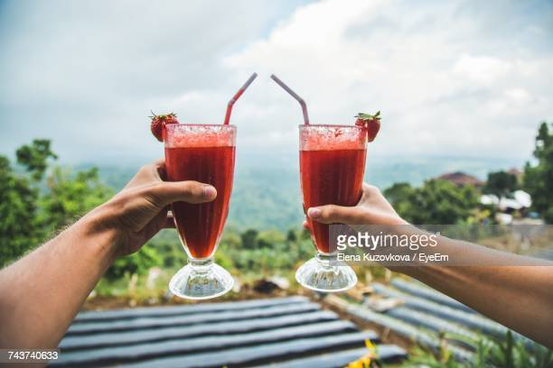 People Toasting With Drinks