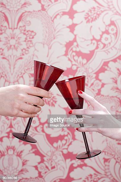 People toasting with wine glases