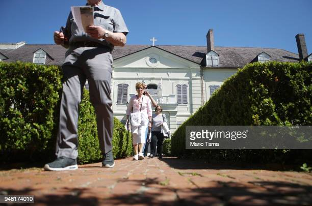 People tour the Old Ursuline Convent the oldest structure in New Orleans in the historic French Quarter on April 17 2018 in New Orleans Louisiana The...