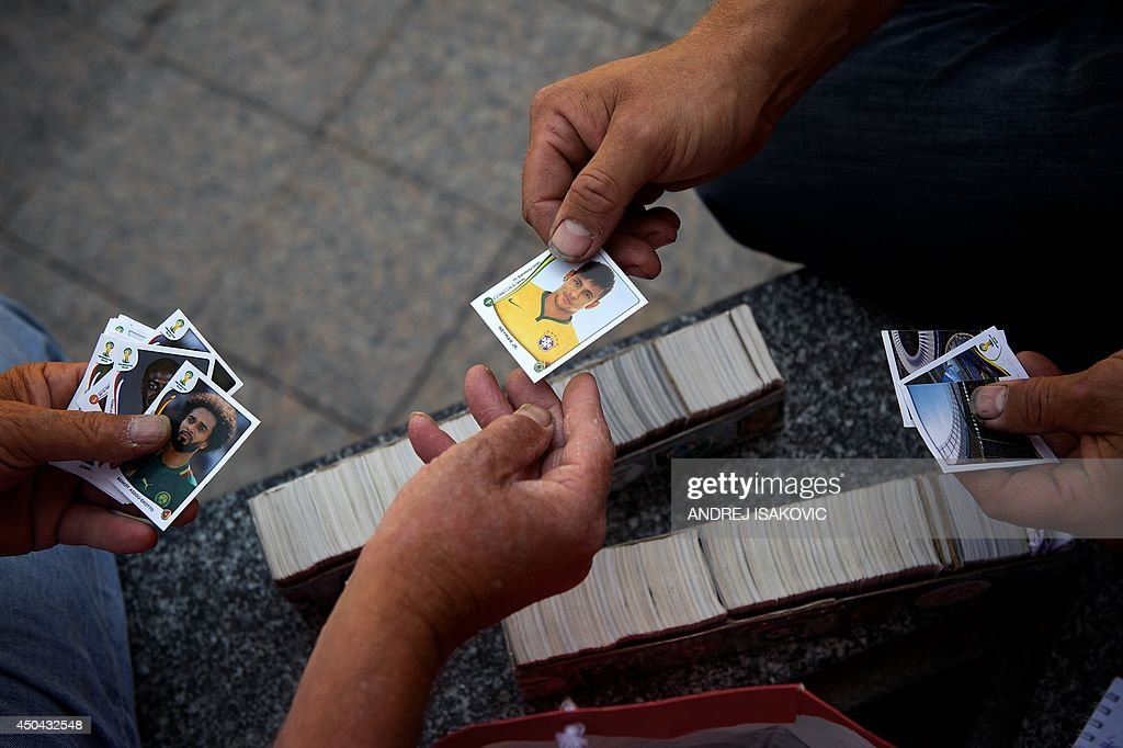 People trade Panini World Cup Soccer stickers in Belgrade on June 11, 2014. Fans of World Cup Soccer are in a rush to fill their Panini albums with all 640 stickers, which include each player for the 32 nations in the tournament plus a team picture, logo and photos of the stadiums, before the kick off on June 12th.