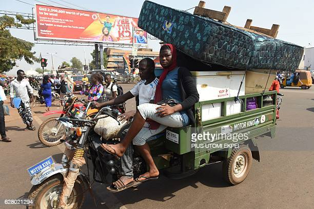 People transport furniture and other household items in Tamale on December 6 2016 on the eve of Ghana's presidential and parliamentary elections /...