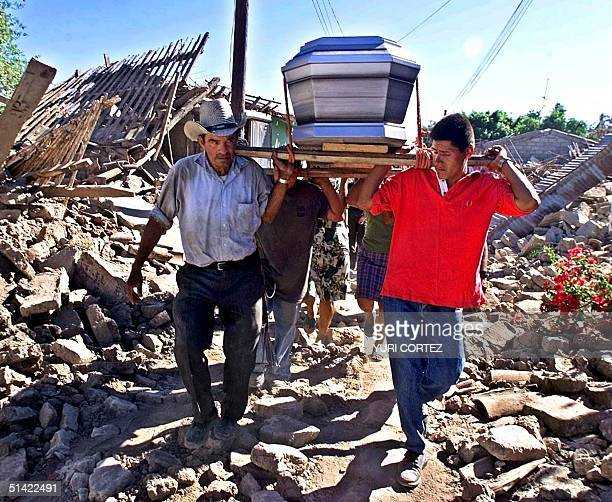 People transport the coffin of a family member 14 February 2001 killed during the earthquake that hit Verapaz El Salvador some 70 kms east of San...