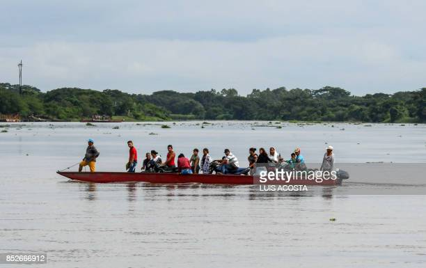 People transport their motorcycles on a boat crossing the Magdalena river in Santa Cruz de Mompox Department of Bolivar September 23 2017 the...