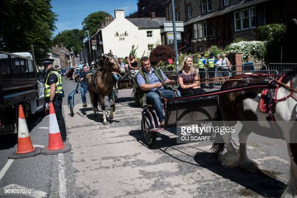 People travel along Battlebarrow Street by horse and trap on the opening day of the annual Appleby Horse Fair, in the town of Appleby-in-Westmorland,...
