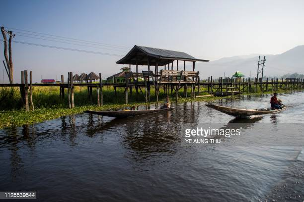 People travel by boats on Inle lake in Shan State on February 18 2019