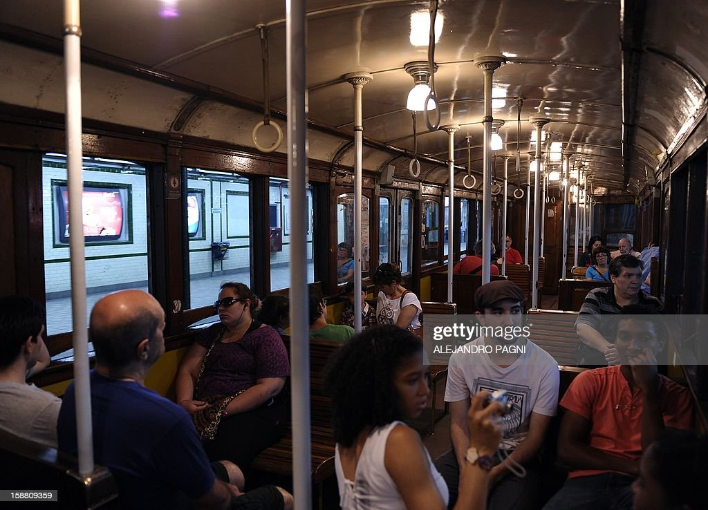 People travel in one of the historic wagons of La Brugeoise of the subway Line A which is expected to be close soon following a decision by city mayor Mauricio Macri to replace the fleet with Chinese-made wagons, in Buenos Aires, on December 29, 2012. Line A was the first subway line to work in the southern hemisphere and its trains are among the ten oldest still working daily. The La Brugeoise wagons were constructed between 1912 and 1919 by La Brugeoise et Nicaise et Delcuve in Belgium.