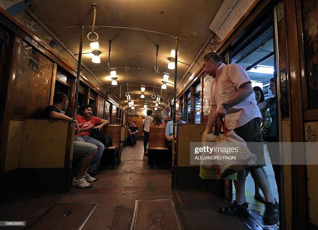 People travel in one of the historic wagons of La Brugeoise of the subway Line A which is expected to be close soon following a decision by city mayor Mauricio Macri to replace the fleet with Chine...
