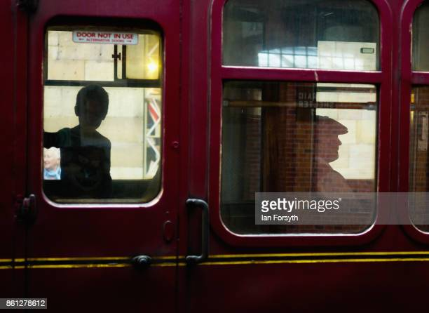 People travel on a railway carriage as they take part in the North Yorkshire Moors Railway 1940's Wartime Weekend event on October 14 2017 in...
