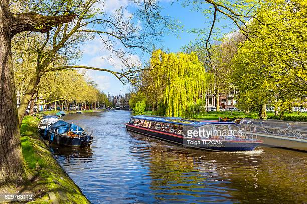 People travel on sightseeing boat through canals