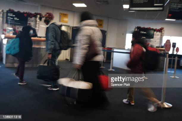 People travel through New York's LaGuardia Airport on December 03, 2020 in New York City. Despite a recent rise in airline travel over the...
