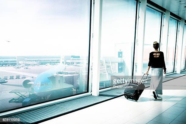 People traveling by airplane on summer holiday