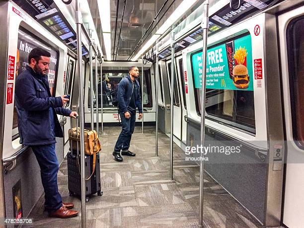 people traveling by train connecting atlanta airport terminals - hartsfield jackson atlanta international airport stock pictures, royalty-free photos & images