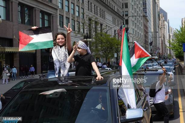 People traveling down Michigan Avenue show support from their cars as demonstrators begin marching through downtown to protest Israeli airstrikes in...