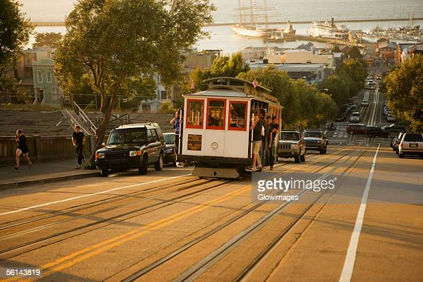 'People traveling in a cable car, San Francisco, California, USA'