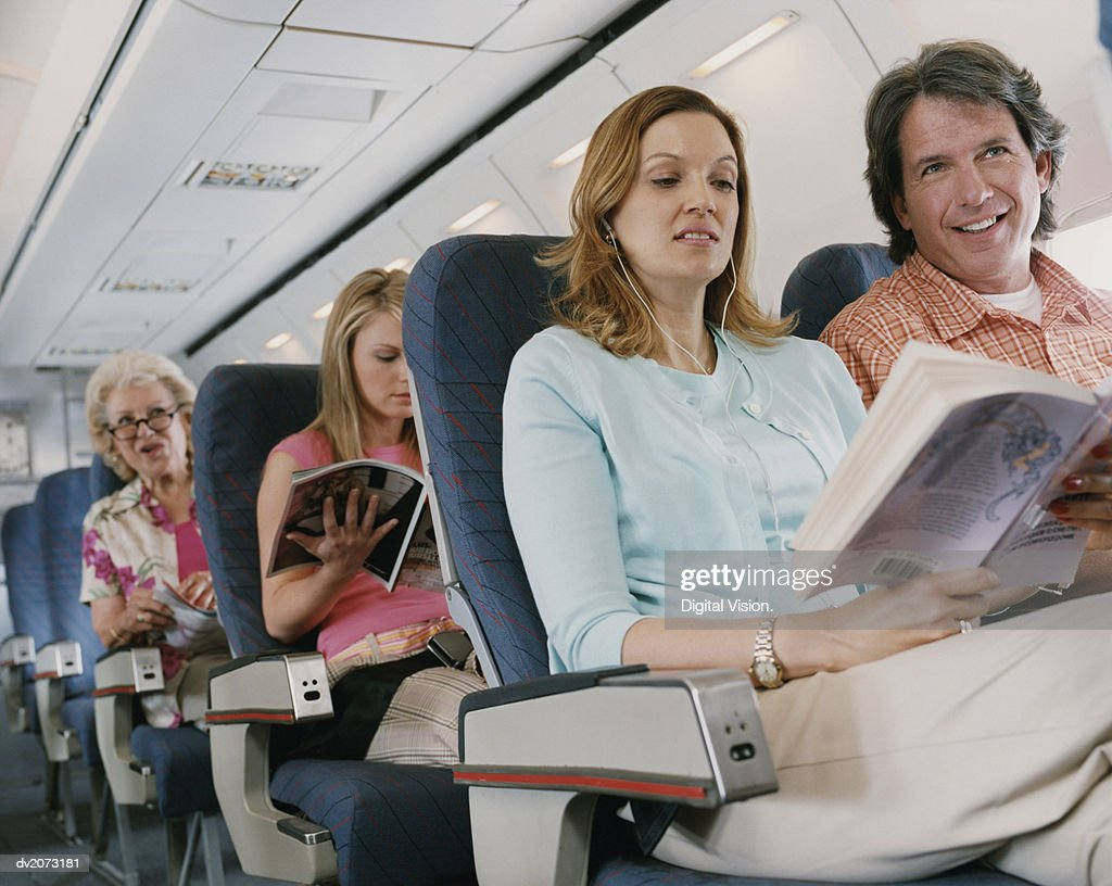 People Traveling in a Plane : Stock Photo